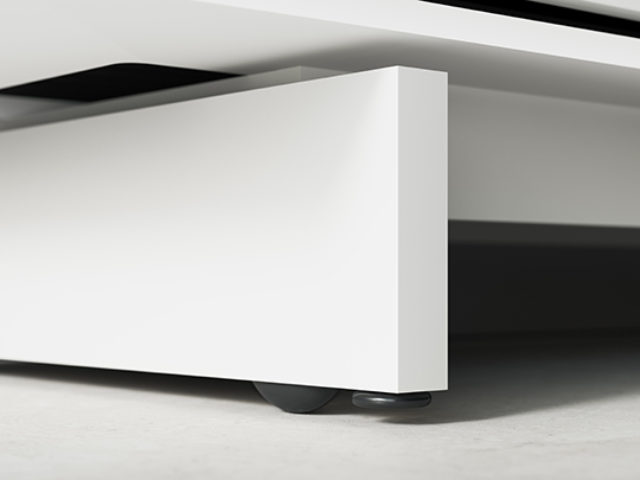 The Align 7477 modern TV stand features concealed wheels that make the cabinet easy to move—and cables easy to access—while maintaining the clean lines of the media base. Lower the levelers to raise it off the wheels to secure it in place.
