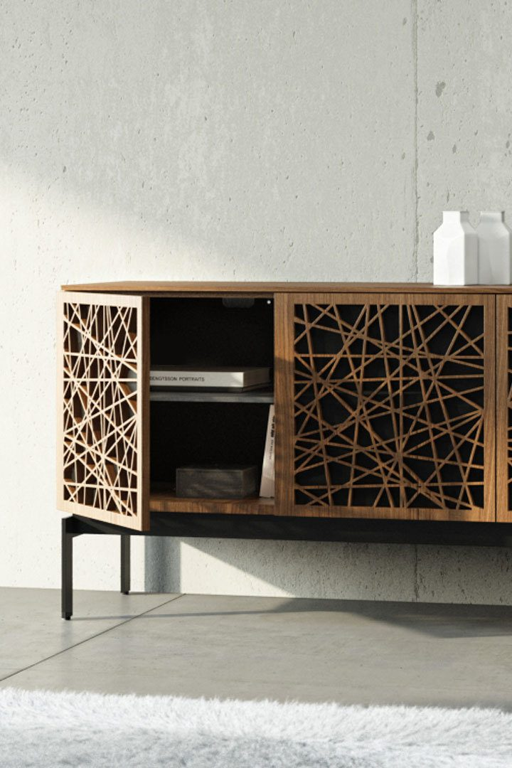 The Elements 8777 credenza by BDI features touch-latch doors conceal ample storage compartments that can also accommodate many AV components, media devices, and gaming consoles.