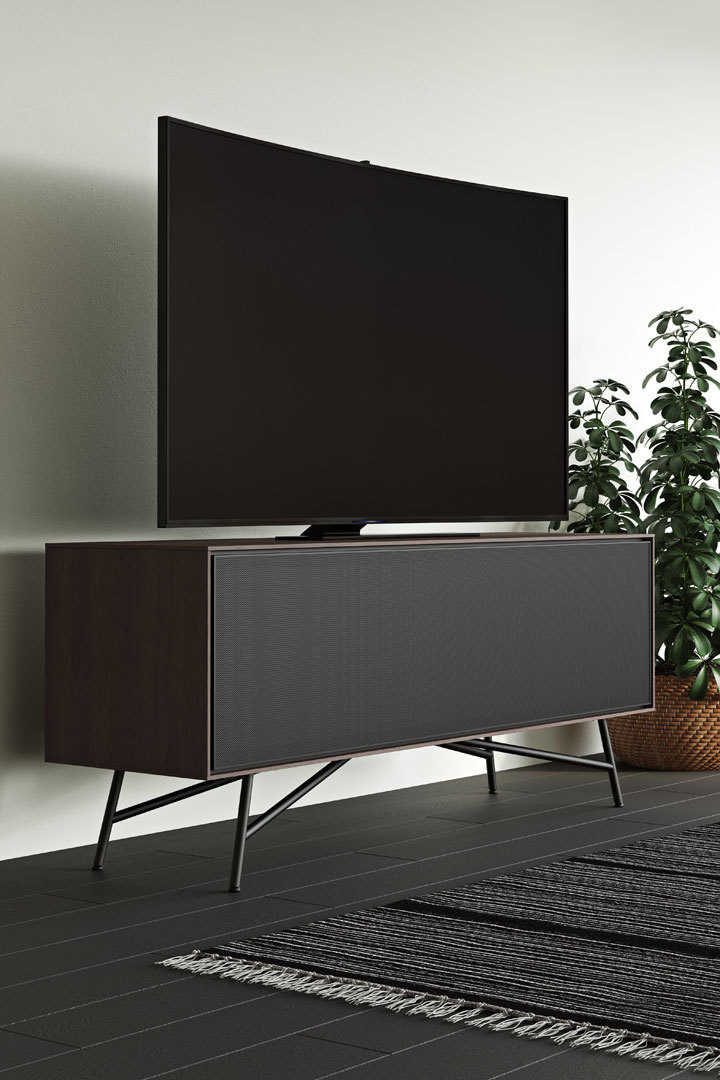 Sector TV stand by BDI in Sepia finish, featuring a remote and soundbar friendly perforated mesh door that flips down to conceal or reveal AV components, a gaming console, and various media devices.