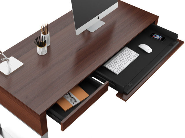 The Cascadia Desk in Walnut by BDI with full size keyboard and storage drawers.