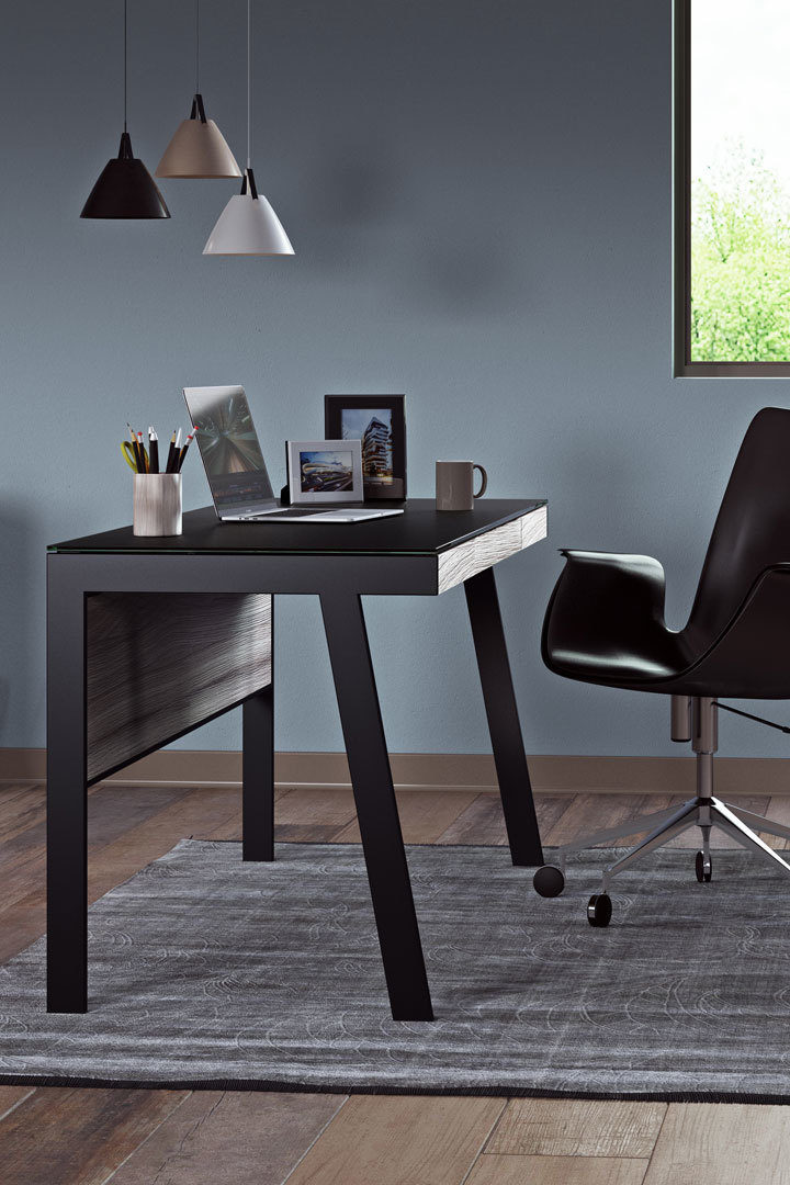 The Sigma 6903 compact laptop desk includes a modesty panel that complements seated use, allows the 6903 to float in a room, and helps to keep wiring neatly concealed.