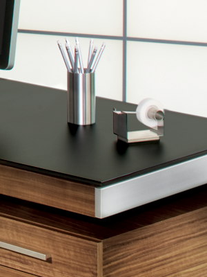 Modern desk from BDI with satin-etched black glass top surface